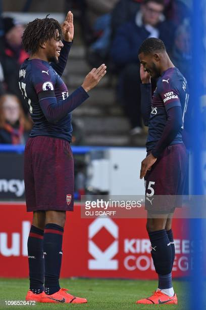Arsenal's Nigerian striker Alex Iwobi celebrates scoring the opening goal with Arsenal's English midfielder Ainsley MaitlandNiles during the English...