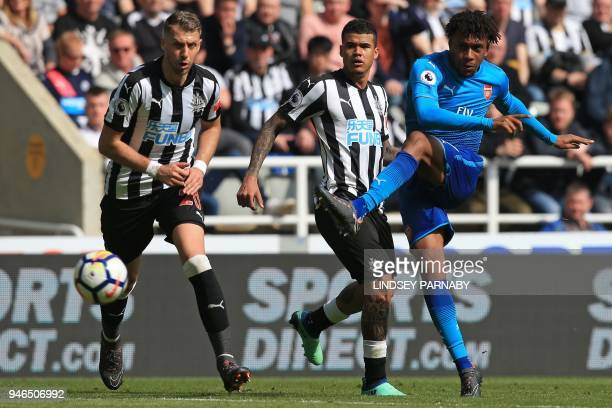 Arsenal's Nigerian striker Alex Iwobi has an unsuccessful shot during the English Premier League football match between Newcastle United and Arsenal...