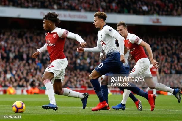 Arsenal's Nigerian striker Alex Iwobi runs away from Tottenham Hotspur's English midfielder Dele Alli during the English Premier League football...