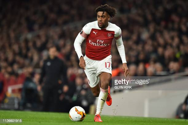 Arsenal's Nigerian striker Alex Iwobi runs with the ball during the UEFA Europa League round of 32 2nd leg football match between Arsenal and Bate...
