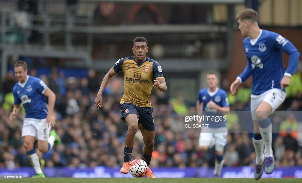 Arsenal's Nigerian striker Alex Iwobi runs with the ball during the English Premier League football match between Everton and Arsenal at Goodison Park in Liverpool, north west England on March 19, 2016. / AFP / OLI SCARFF / RESTRICTED TO EDITORIAL USE. No use with unauthorized audio, video, data, fixture lists, club/league logos or 'live' services. Online in-match use limited to 75 images, no video emulation. No use in betting, games or single club/league/player publications. /