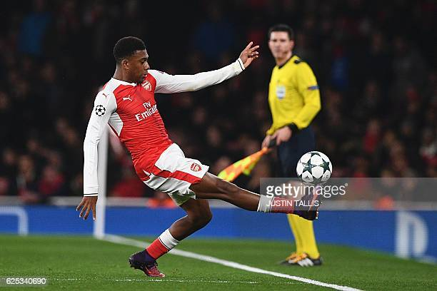 Arsenal's Nigerian striker Alex Iwobi tries to control the ball during the UEFA Champions League group A football match between Arsenal and Paris...