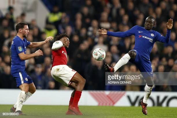 Arsenal's Nigerian striker Alex Iwobi vies with Chelsea's English midfielder Danny Drinkwater and Chelsea's French midfielder N'Golo Kante during the...