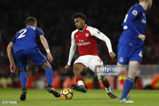 Arsenal's Nigerian striker Alex Iwobi vies with Everton's French midfielder Morgan Schneiderlin during the English Premier League football match...