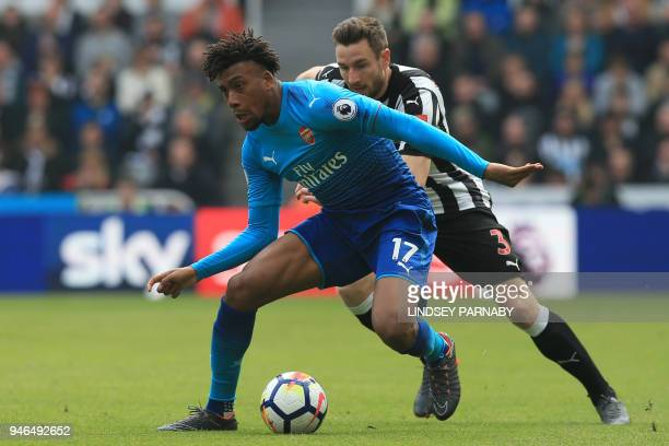 Arsenal's Nigerian striker Alex Iwobi vies with Newcastle United's Welsh defender Paul Dummett during the English Premier League football match...