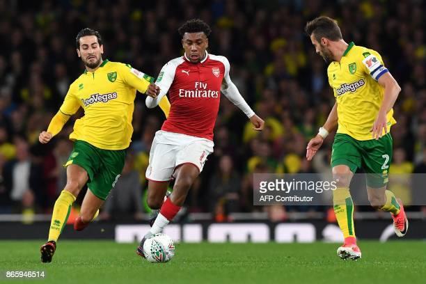 Arsenal's Nigerian striker Alex Iwobi vies with Norwich City's Bosnian midfielder Mario Vrancic and Norwich City's Portuguese defender Ivo Pinto...