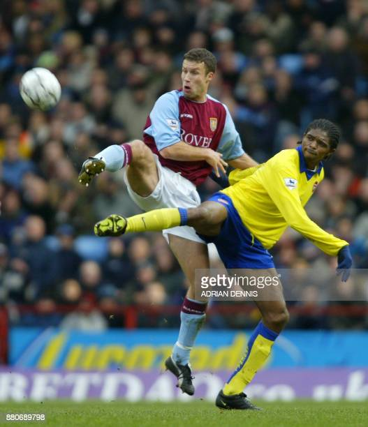 Arsenal's Nwanku Kanu fights for posession against Ronnie Johnsen of Aston Villa during their Premiership match at Villa Park in Birmingham 18...