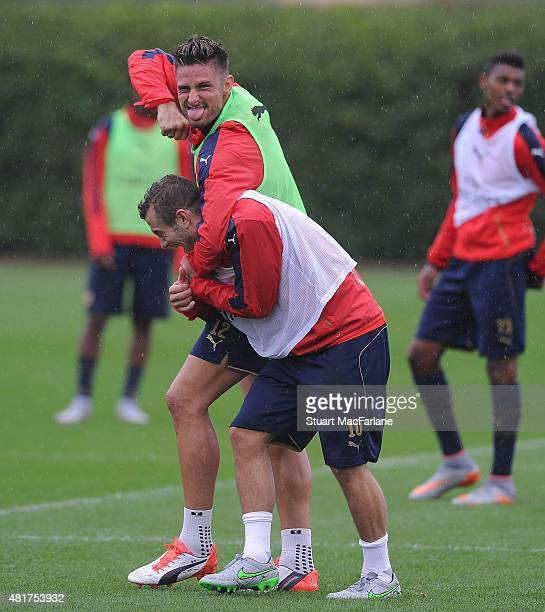 Arsenal's Olivier Giroud and Jack Wilshere mess around during a training session at London Colney on July 24, 2015 in St Albans, England.