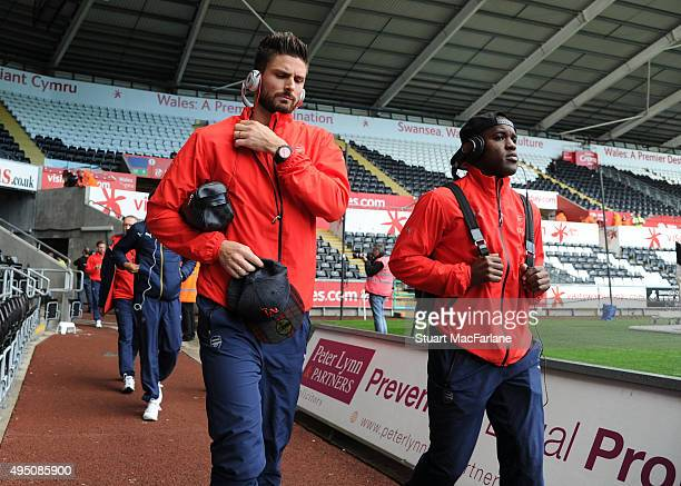 Arsenal's Olivier Giroud and Joel Campbell arrive at the Liberty Stadium before the Barclays Premier League match between Swansea City and Arsenal on...