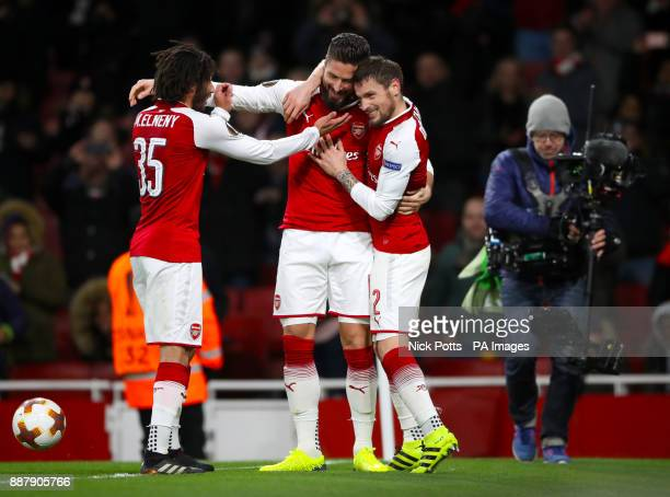 Arsenal's Olivier Giroud celebrates scoring his sides fifth goal from the penalty spot with team mates Arsenal's Mohamed Elneny and Arsenal's Mathieu...