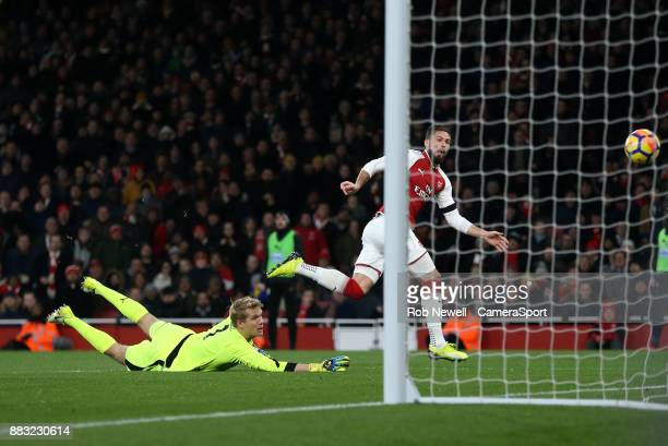 Arsenal's Olivier Giroud hits the post in the second half during the Premier League match between Arsenal and Huddersfield Town at Emirates Stadium...