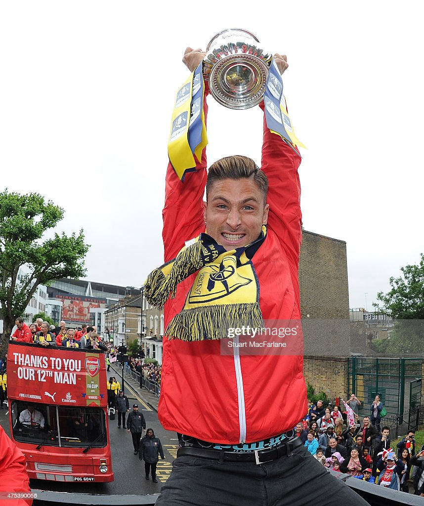 Arsenal's Olivier Giroud poses with the cup during the Arsenal FA Cup Victory Parade in Islington on May 31, 2015 in London, England.