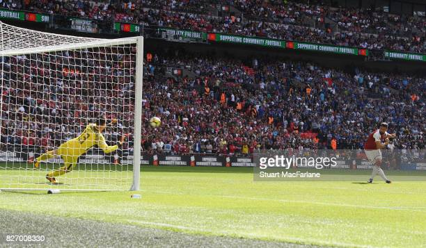 Arsenal's Olivier Giroud shoots past Chelsea goalkeeper Thibaut Courtois to score the winning penalty in the shoot out during the FA Community Shield...
