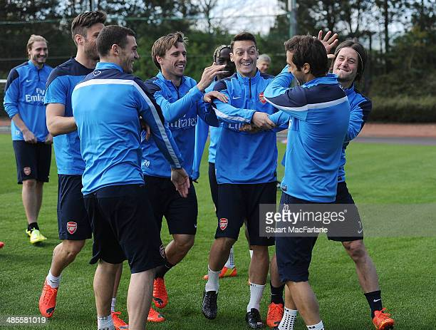 Arsenal's Olivier Giroud, Thomas Vermaelen, Nacho Monreal, Mesut Ozil, Mathieu Flamini and Tomas Rosicky mess around before a training session at...