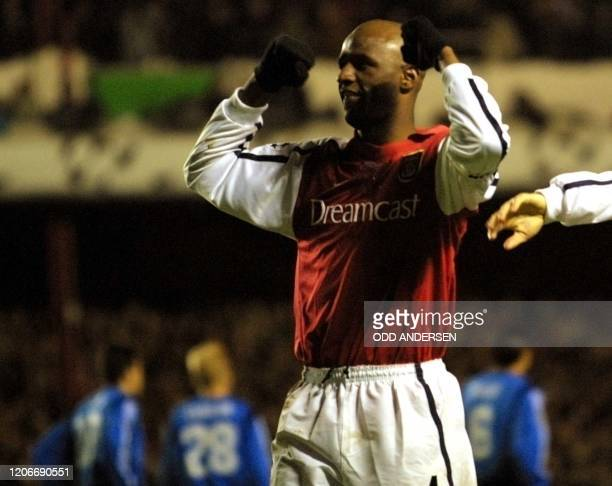Arsenal's Patrick Vieira celebrates a goal against Bayer Leverkusen during a phase two Champions league match at Highbury stadium in London 27...