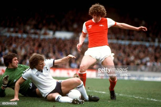 Arsenal's Paul Vaessen is denied by Tottenham Hotspur's Barry Daines and Chris Jones