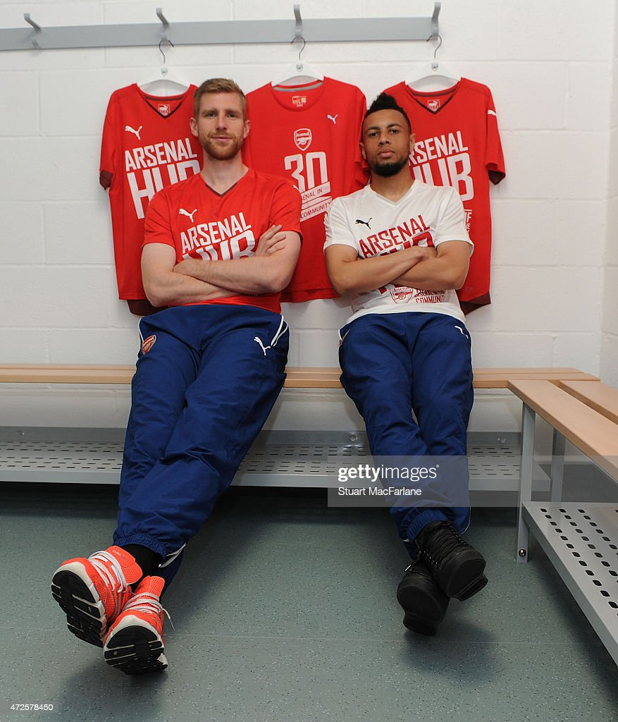 Arsenal's Per Mertesacker and Francis Coquelin visit the Arsenal Community Hub at Emirates Stadium on May 8, 2015 in London, England.
