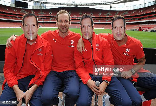Arsenal's Per Mertesacker, Laurent Koscielny Olivier Giroud wear 'Cech' masks with goalkeeper Petr Cech during a Q & A during Members Day at Emirates...