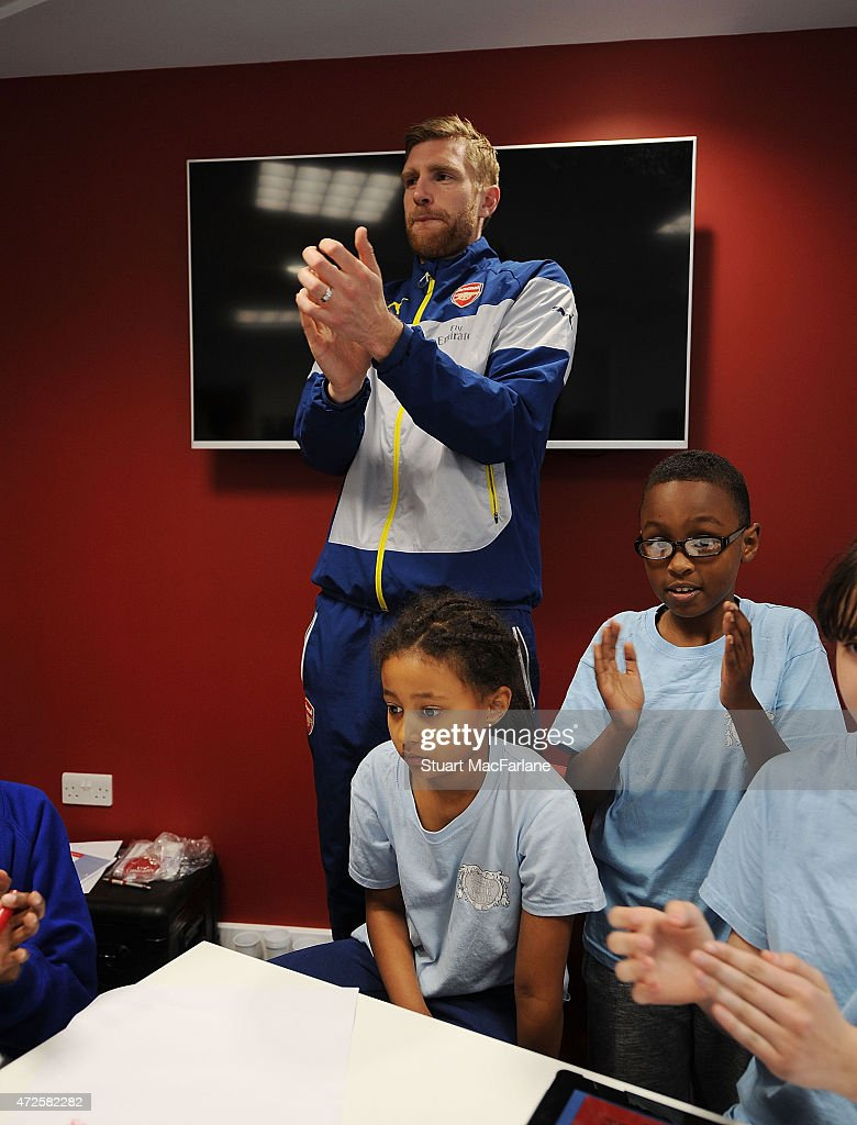 Arsenal's Per Mertesacker visits the Arsenal Community Hub at Emirates Stadium on May 8, 2015 in London, England.