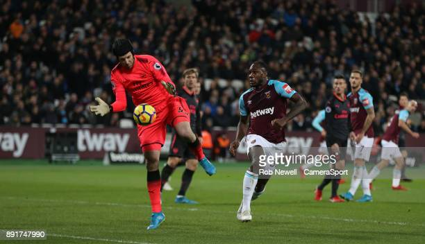 Arsenal's Petr Cech gathers from West Ham United's Michail Antonio during the Premier League match between West Ham United and Arsenal at London...