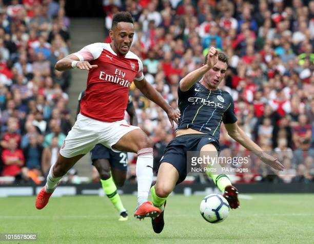 Arsenal's PierreEmerick Aubameyang and Manchester City's Aymeric Laporte battle for the ball during the Premier League match at the Emirates Stadium...