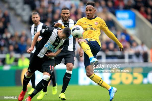 Arsenal's PierreEmerick Aubameyang and Newcastle United's Javier Manquillo battle for the ball during the Premier League match at St James' Park...