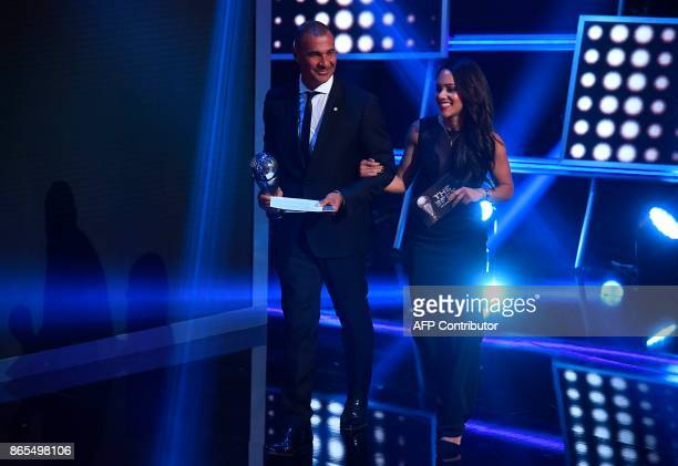 Arsenal's player Alex Scott and Netherland's former player Ruud Gullit come on stage to present the The Best FIFA Women's Coach of 2017 Award during...