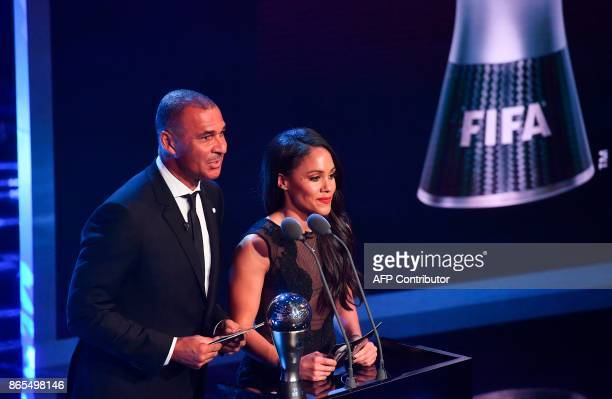 Arsenal's player Alex Scott and Netherland's former player Ruud Gullit present the The Best FIFA Women's Coach of 2017 Award during The Best FIFA...