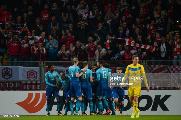 Arsenal's players celebrate a goal during the UEFA Europa League Group H football match between FC BATE Borisov and Arsenal FC in Borisov outside...