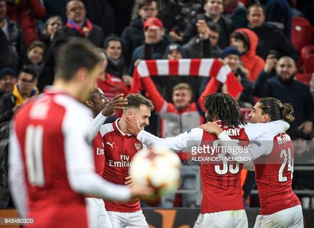 TOPSHOT Arsenal's players celebrate a goal during the UEFA Europa League second leg quarterfinal football match between CSKA Moscow and Arsenal at...