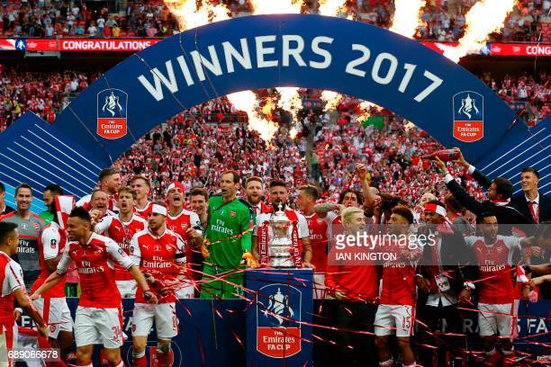 TOPSHOT Arsenal's players celebrate after their win over Chelsea on the pitch after the English FA Cup final football match between Arsenal and...