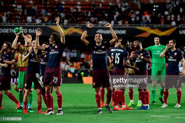 Arsenal's players celebrate at the end of the UEFA Europa League semifinal second leg football match between Valencia CF and Arsenal FC at the...