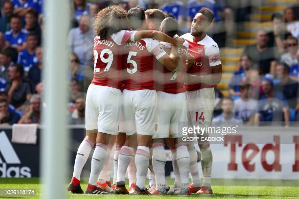 Arsenal's players celebrate their opening goal scored by Arsenal's German defender Shkodran Mustafi during the English Premier League football match...