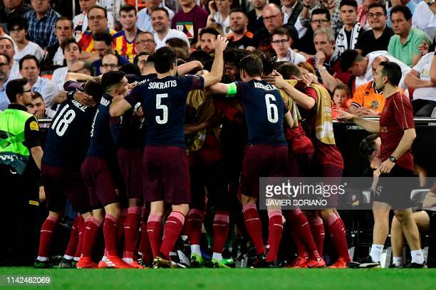 Arsenal's players celebrate their second goal during the UEFA Europa League semifinal second leg football match between Valencia CF and Arsenal FC at...
