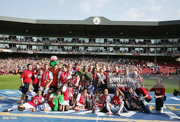 Arsenals players celebrate winning the Premiership during the FA Barclaycard Premiership match between Arsenal and Leicester City at Highbury on May...