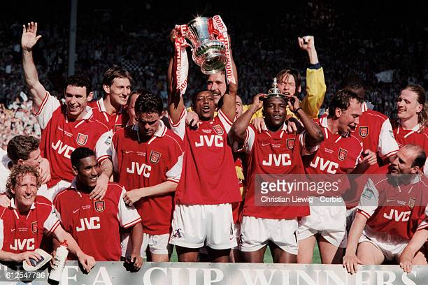 Arsenal's players celebrate with trophy after winning the 19971998 FA Cup Final against Newcastle Utd