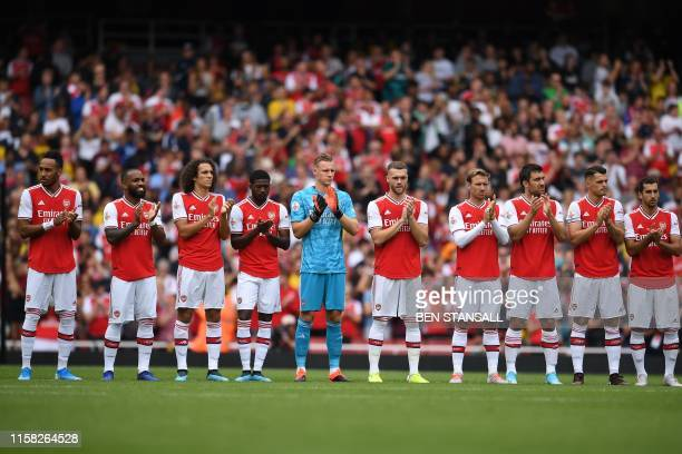 Arsenal's players observe a minute's applause for former Arsenal and Spain midfielder Jose Antonio Reyes, who died in a traffic accicent in June,...