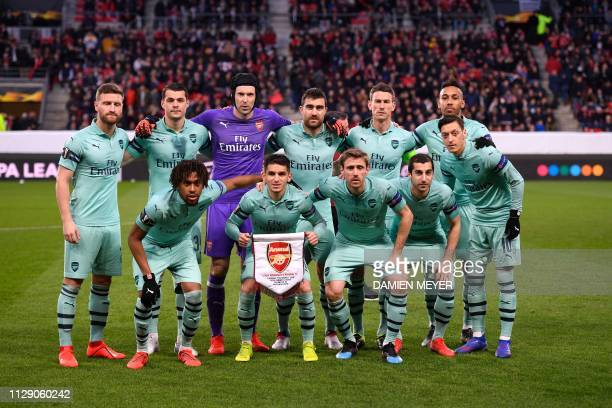 Arsenal's players pose before the UEFA Europa League round of 16 first leg football match between Stade Rennais FC and Arsenal FC at the Roazhon Park...