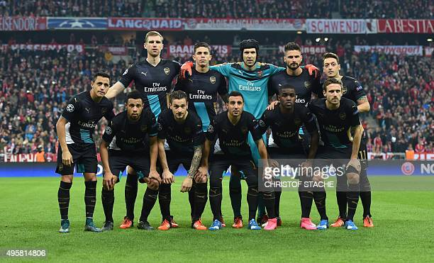 Arsenal's players pose for a team picture prior to the UEFA Champions League Group F secondleg football match between FC Bayern Munich and Arsenal FC...