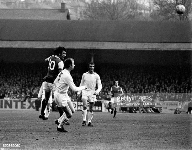 Arsenal's Ray Kennedy outjumps Leeds United's Jack Charlton as Paul Madeley looks on