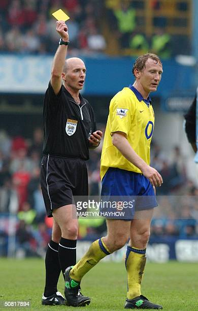 Arsenal's Ray Parlour is booked by referee M Dean 09 May 2004 West London in the match against Fulham