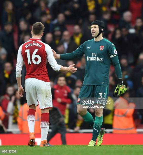 Arsenal's Rob Holding and Petr Cech after the Premier League match between Arsenal and Watford at Emirates Stadium on March 10 2018 in London England