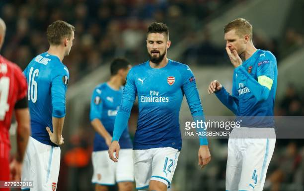 Arsenal's Rob Holding Olivier Giroud and Per Mertesacker react during the UEFA Europa League football match 1 FC Cologne v Arsenal FC on November 23...