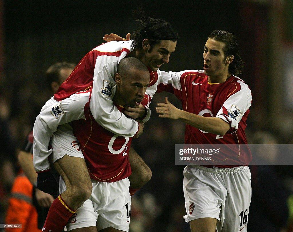 Arsenal's Robert Pires (top) and Mathieu : News Photo