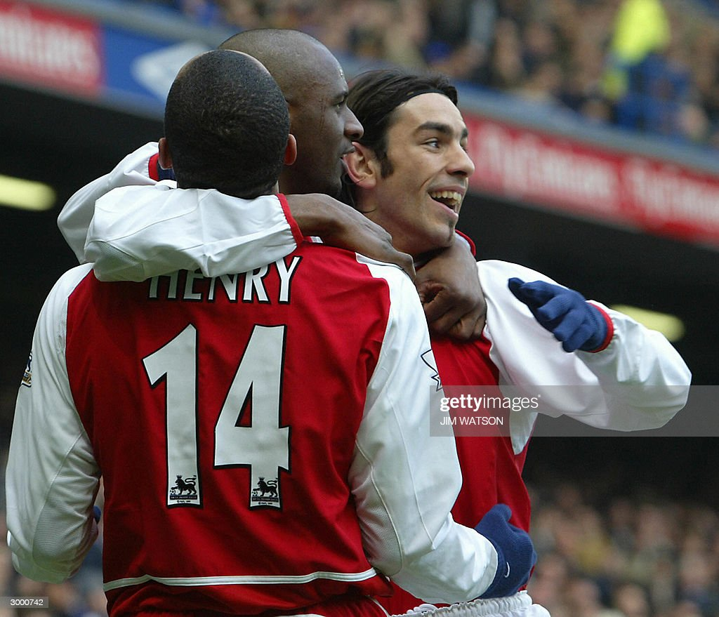 Arsenal's Robert Pires (R) is celebrates scoring against Chelsea with teammates Thierry Henry and Patrick Vieira during their FA Premiership match 21 February, 2004 at Stamford Bridge in London.