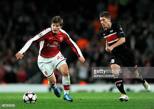 Arsenal's Russian midfielder Andrey Arshavin vies for the ball against AZ Alkmaar's Stijn Schaars during the Champions League Group H football match...