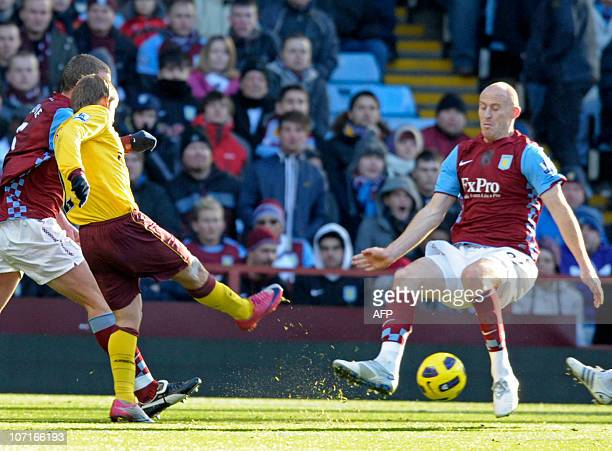 Arsenal's Russian striker Andrey Arshavin shoots past Aston Villa's Welsh defender James Collins to score the opening goal of the English Premier...