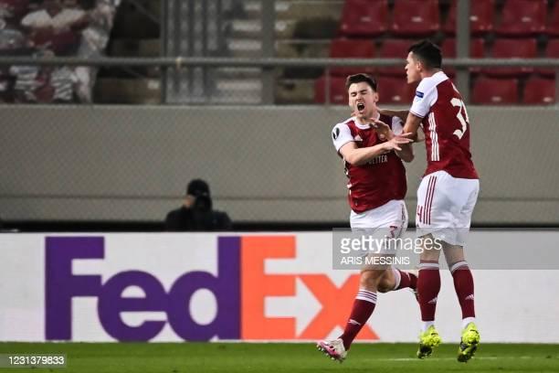 Arsenal's Scottish defender Kieran Tierney celebrates after scoring a goal during the UEFA Europa League 32 Second Leg football match between Arsenal...