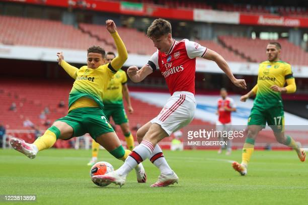 Arsenal's Scottish defender Kieran Tierney fights for the ball with Norwich City's English defender Max Aarons during the English Premier League...