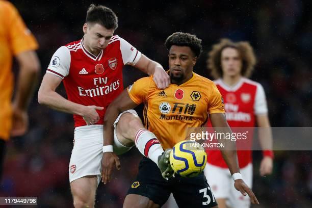Arsenal's Scottish defender Kieran Tierney vies with Wolverhampton Wanderers' Spanish striker Adama Traore during the English Premier League football...